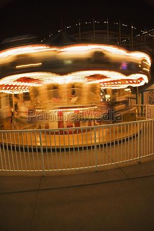 facade of a carousel at night
