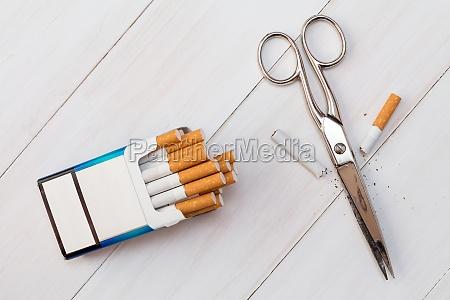 cutting cigarette by scissors