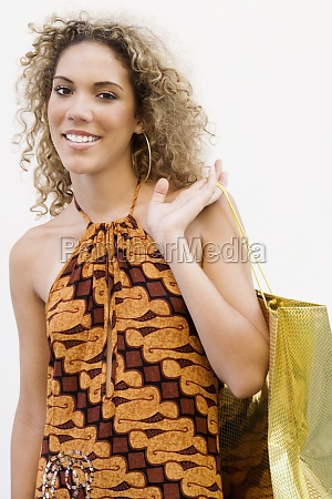 portrait of a teenage girl carrying