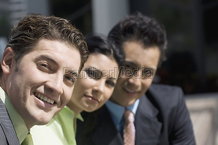 portrait of two businessmen and a