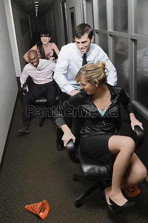 office workers playing in an office