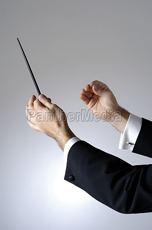 close up of a conductor holding