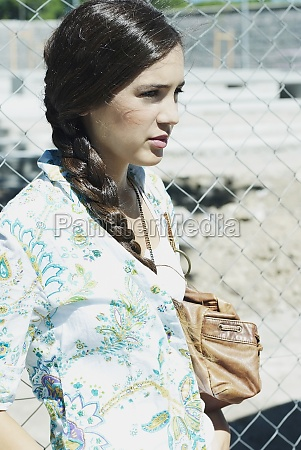 closeup of a young woman carrying