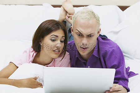 closeup of a young couple using