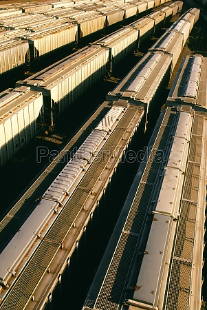 freight cars waiting on tracks in