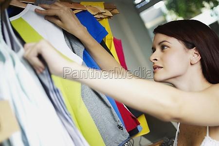 closeup of a young woman selecting