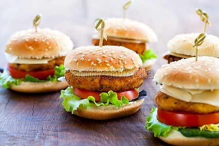 appetizing mini chicken burgers on wooden