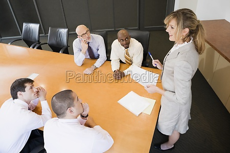 businesswoman giving a presentation in a