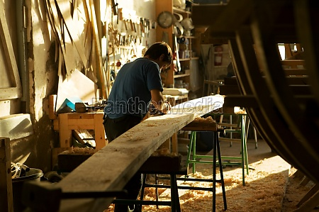 rear view of a carpenter working