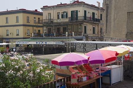 patio umbrellas in a market borgo
