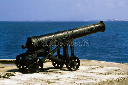 side view of a dockyard canon