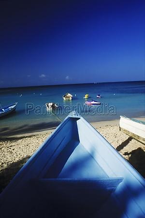 boats moored on the beach caribbean