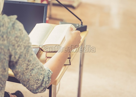 learning for exams blonde female student