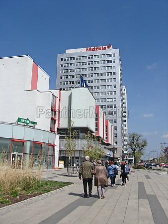 people walk through city urban bustle