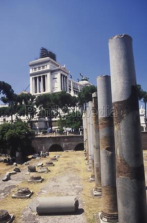broken columns in front of a