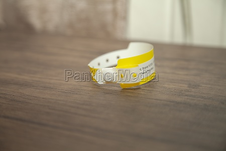 yellow hospital bracelet