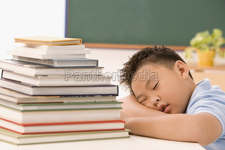 boy napping in a classroom