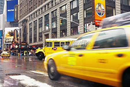 yellow taxi on the road