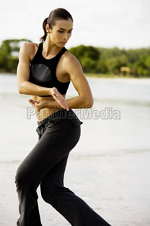 young woman practicing martial arts on