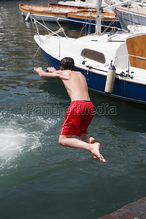 rear view of a boy jumping