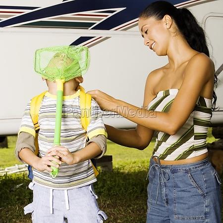 mother adjusting her sonZs backpack