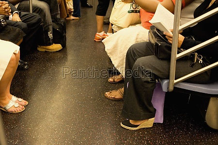 passengers sitting in a subway train