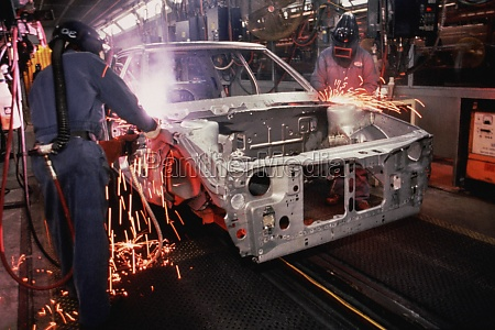 workers weld car bodies chrysler plant