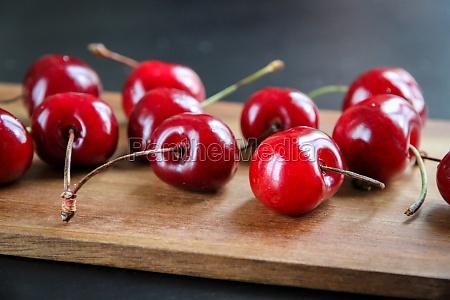 fresh cherries on a wooden cutting