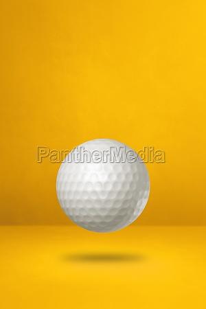 white golf ball on a yellow