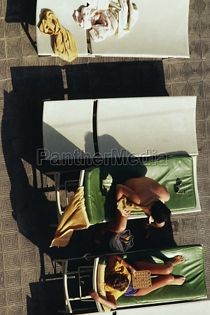 top view of women sunbathing on