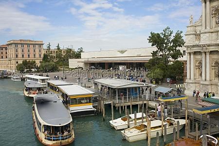 gondolas docked in a canal in