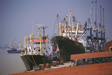 container ships moored at a dock