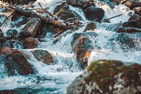 icy mountain river icicles on a