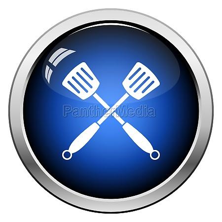 crossed frying spatula