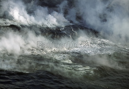 plumes of stream rising from molten