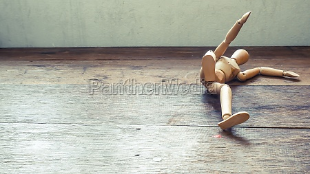 wooden mannequin falling down fall concept