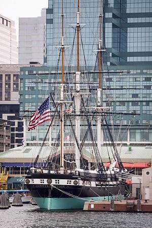 tall ship moored at a harbor