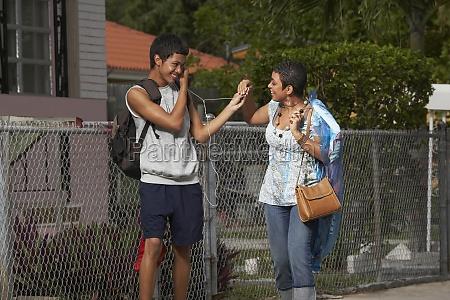 teenage boy and his sister sharing