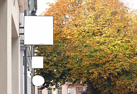 three empty outdoor wall signboards in