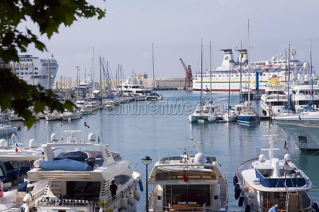 industrial ship and boats moored at