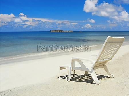 empty lounge chair on the beach