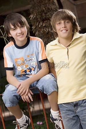portrait of two schoolboys smiling together