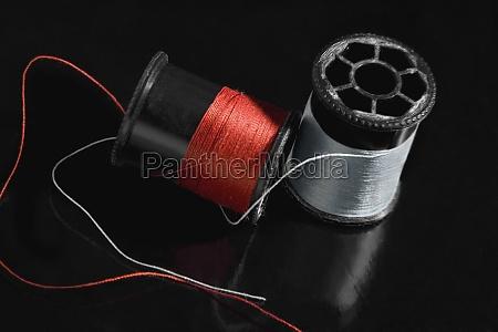 closeup of two thread spools