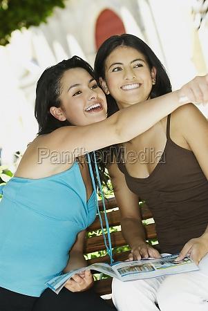 closeup of two young women smiling