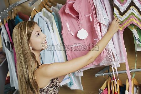 closeup of a young woman choosing
