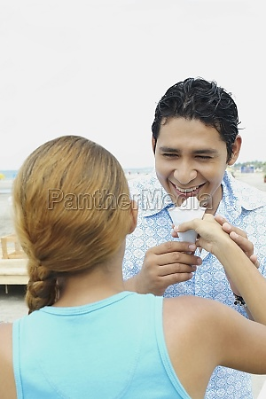 young woman holding an icecream in