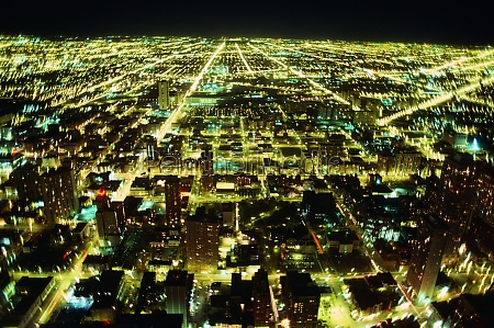 aerial view of a city lit