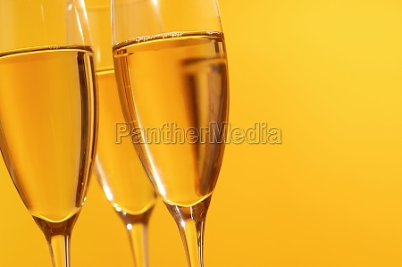 close up of champagne in three