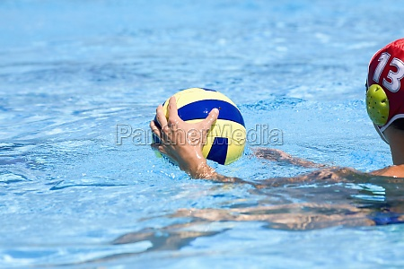 man playing water polo in a