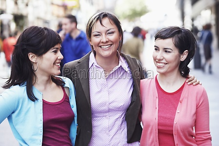 three young women standing on the